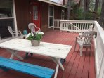 The outside deck is like another living room. Comes with a gas grill and plenty of seating.