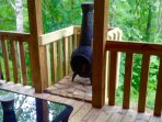 Back deck sitting area has a fire chiminea