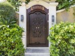Villa entrance with Balinese style door complete with lock and bolt for your added security