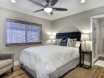 Master bedroom with queen size bed and ceiling fan