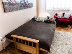 Futon open. Supplied with protector, linen, duvet and pillows.