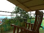 The covered terrace overlooks the valley, just perfect for reading among the clouds.