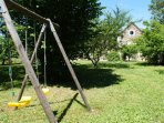 2 swings for the children at the end of the large and enclosed orchard garden
