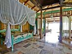 Villa: Master bedroom, looking out to the veranda.