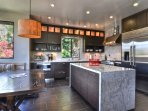 Modern kitchen and breakfast nook is a cook's dream!
