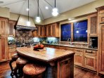 Welcoming kitchen with colorful tile and island seating for 3
