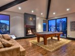 Pool table and fireplace. What a wonderful combination