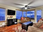 Living room large screen TV and ocean views.