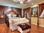 Beautiful spacious master bedroom with king bed and sofa