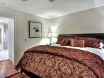 King size bed in master bedroom also has private outside balcony.