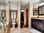 Master bathroom with double sinks and warm luxury