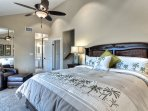 Comfortable master bedroom with private bathroom.