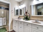 Large master bathroom with double sinks and shower