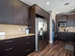 Gorgeous modern kitchen with washer and dryer too!