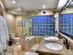 Large travertine and glass shower for 2nd floor shared bathroom