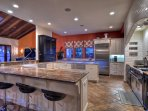 Gourmet kitchen with professional appliances and granite countertops