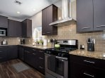 Ample counter space and all new appliances in the kitchen.