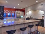 Plenty of bar stool seating in the kitchen