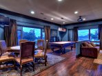 Amazing upstairs game room with card table, big screen TV
