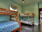 Kids bunk-bed room has closet and their own television