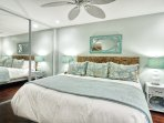 Master bedroom has king size bed and spacious mirrored closet.