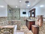 Master bathroom has double sinks and beautiful tile.