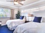 Twin bedroom with ocean views