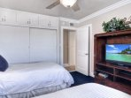 Twin bedroom has a flat screen tv and large closet