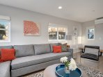 A queen size sleeper sofa in the living room sleeps an additional two guests
