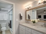 The private master bathroom includes double sinks and a spacious shower.