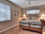 Guest queen bedroom also has a large closet and view of front deck.