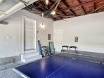 Garage fits two cars, or use it as a space to play ping-pong!