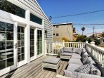 Step outside onto the deck! Here you'll find ample seating, and lots of sun!