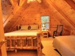 Upstairs bedroom, king log bed and single