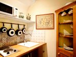 The kitchenette features a cook top, fridge, and microwave - just right for morning coffee and snack