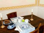The dining alcove seats up to six and you set the table with antique china and silver.