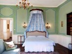 A traditional French canopy adorns the queen size bed.