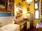 The kitchen has a full-size Italian gas range, large fridge, dishwasher, and is fully equipped.