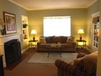 Living room with fireplace, TV, comfortable seating