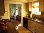 Kitchen with view into dining room. Dishwasher and sink