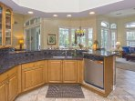 Bright and spacious gourmet kitchen with granite, perfect for entertaining