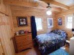 Main Floor Bedroom -Log Cabin in Rum Ridge