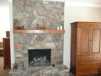 Huge rustic fireplace with remote control logs. Large LED TV in armoir.