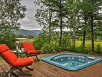 Soak in the private hot tub and enjoy the views!