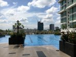 Full size swimming pool with children's pool, overlooking the city