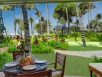 Lanai with ocean views, lounge, and dining table