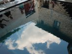 Pool with sky reflection.