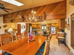 Enjoy family meals around the dining room table that seats 8.