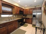 Kitchen with Stainless Stee Applieances &Granite Counter Tops