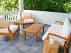 Teak patio furniture with ocean and garden views